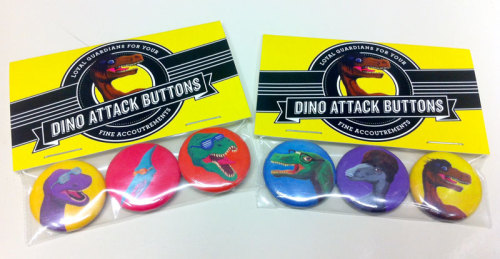 ironcladfolly:  Dino Attack Buttons: Loyal Guardians for your fine accoutrements Available for purchase at the Royal Bison Craft & Art Fair!  These are all the fun! (In case you missed Biebersaurus)