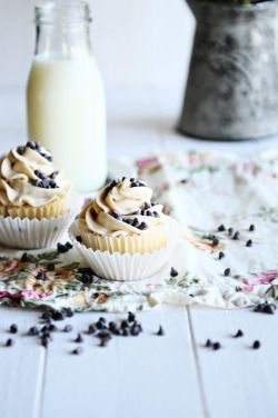 French Vanilla Cupcakes with Chocolate Chip Cookie Dough Frosting Cupcake Ingredients:  1 cup unsalted butter, room temperature 2 cups of vanilla sugar 2 large eggs, room temperature 2 egg yolks, room temperature 3 cups all-purpose flour 1 teaspoon baking powder 1 teaspoon of baking soda Pinch of salt 1 cup of buttermilk, room temp 2 teaspoons of vanilla extract 1 1-inch piece of  vanilla bean Frosting Ingredients:  3 sticks unsalted butter, at room temperature ¾ cup light brown sugar, packed 3½ cups confectioners' sugar 1 cup all-purpose flour ¾ tsp. salt 3 tbsp. milk 2½ tsp. vanilla extract Cupcake Directions:  Preheat oven to 350F. Heat the buttermilk until it just simmers. Remove from heat and add the vanilla pod. Set aside. Beat butter and sugar on high until light and fluffy. Add eggs and egg yolks one at a time, beat thoroughly after each addition. Blend flour, baking powder, salt and baking soda, in a bowl. Cut open vanilla pod and scrape out seeds into the buttermilk. (You can dry the pod and use it to make vanilla sugar) Add 1/3 of the flour mixture to the butter mixture and beat on low until mixed. Add ½ the buttermilk. Continue to alternate the flour and buttermilk, ending with the flour. Scoop into cupcake papers about 3/4 full. Bake for 18-20 minutes. Cool.  Frosting Directions:  Beat butter and brown sugar with the paddle attachment on high speed until creamy and fluffy. Mix in the confectioners' sugar until smooth. Beat in the flour and salt. Mix in the milk and vanilla extract until smooth and combined.