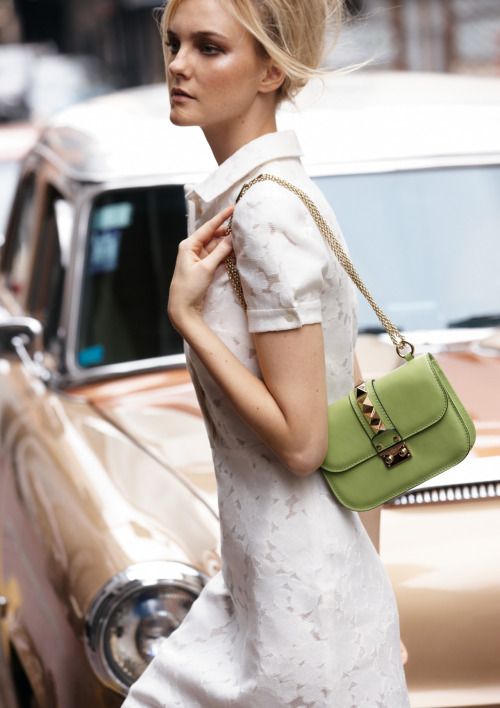 Summer in the city calls for the perfect LWD and pistachio-colored handbag.