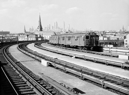 """A Subway Road Comes up for air in Brooklyn — in background, a view of Manhattan from subway elevated tracks, 8th Street, Brooklyn, New York, on March 21, 1938."" (Historic Photos From the NYC Municipal Archives - In Focus - The Atlantic)"