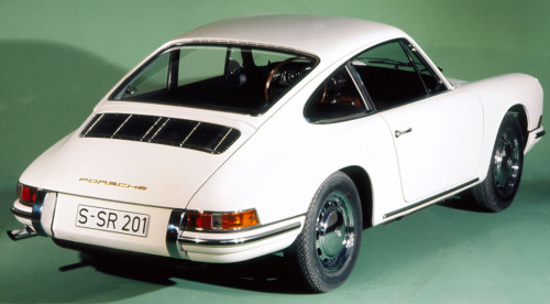 Porsche 911 2.0 (1964) The original short wheelbase version with a couple of triple carbs on its back (literally).