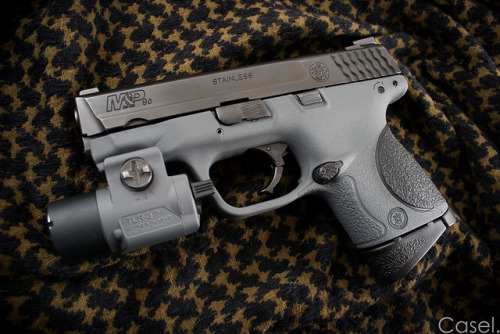 "Duracoat'd S&W M&P9c on Flickr. Latest duracoat job I just finished. I realized I posted this on Instagram (@CaselxASD) but never posted the high-res I promised, so here it is! The frame on my brother's Smith & Wesson Military & Police 9mm Compact handgun is wearing ""Tactical Extreme Gray"" Duracoat. The Streamlight TLR-3 weapon light was also duracoated to match. All in all I think its an AWESOME combo with the orginal black parts of both the M&P and the TLR-3 Light. Enjoy!"