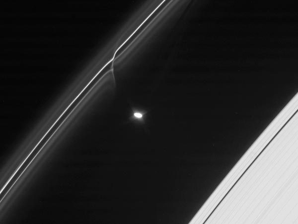 "the-star-stuff:  Huge ""Snowballs"" Seen Piercing Saturn's Outer Ring Giant ""snowballs"" have been discovered plunging through Saturn's outermost ring, creating glittering trails of ice dubbed mini-jets, researchers have announced. Image courtesy Caltech/SSI/QMUL/NASA"