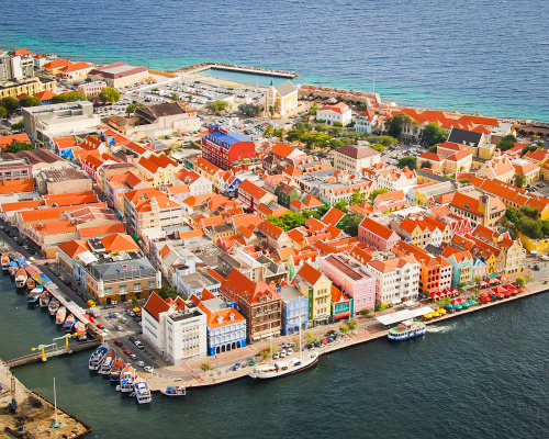 lickystickypickywe:  Curaçao, Dutch Caribbean.The capital Willemstad has gorgeous architecture in its historic centre and the buildings on the dock there are protected and on the Unesco World Heritage List.