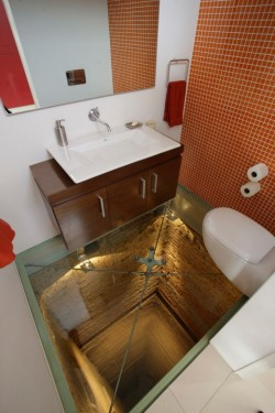 Jaw-dropping Guadalajaran powder room sitting atop the peak of an unused 15-story elevator shaft. At least you'll already be in the bathroom when you shit yourself. Via Colossal.
