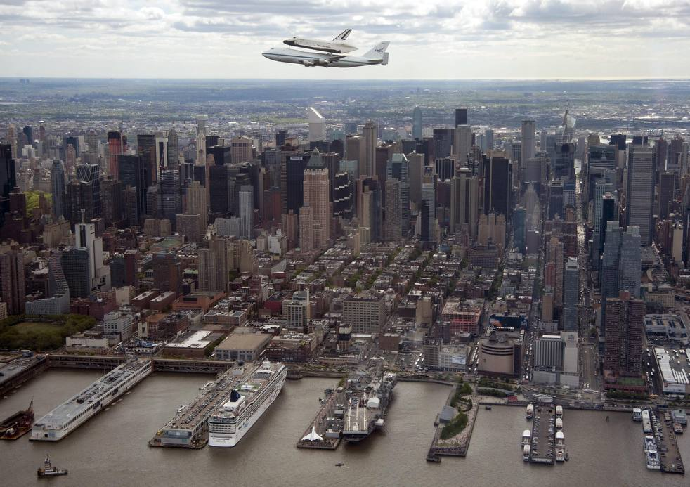 Space Shuttle Enterprise flies over New York  In this photo provided by NASA, Space shuttle Enterprise, riding on the back of the NASA 747 Shuttle Carrier Aircraft, flies over New York on Friday, April 27, 2012. Enterprise is eventually going to make its new home in New York City at the Intrepid Sea, Air and Space Museum. AP / Robert Markowitz  Follow @sacbee_theframe  Read more here: http://blogs.sacbee.com/photos/2012/04/space-shuttle-arrives-in-nyc-c.html#storylink=cpy