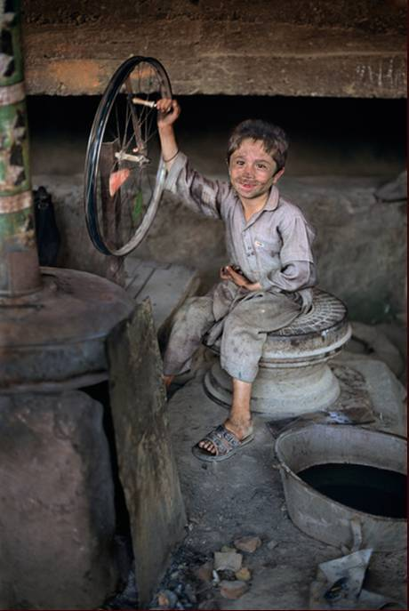There are a lot of children in Afghanistan, but little childhood.  Khaled Hosseini, The Kite Runner   Photo: Steve McCurry