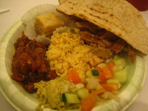 Day 27: Shabbat Supper (Baklava, Shawarma, challah, hummus, couscous, pesto, etc) After a sweaty, strenuous afternoon of Quidditch, starvation was the prevalent state of emotions my body was undergoing. Most went to Shafer, but Tim invited Darren and I to Shabbat supper with some of his fraternity brothers, promising the finest in Jewish cuisine. Granted, after going to Hanukkah at his house this year, those were words I was more than willing to trust.  The fine folks of Hillel of VCU, after a few prayers and introductory remarks, turned us loose on a buffet-style feast. Though I'd definitely had a few things before, there was way too much for me NOT to find something. One of Tim's brothers scooped a bunch of shawarma on my plate, which is a specially-prepared dish of meats traditionally eaten with pita. The juices were sopped up by the bread, making for an even more delicious experience. The verdict? Succulent and satisfying. As for the baklava (a pastry dessert made with honey, syrup and nuts), my mind was thoroughly blown. For someone who eats chocolate on the daily, I have to give this props. My cutlery couldn't handle it, but my stomach was happy to oblige. Not what I was expecting at all, but a victory all around.  Pregaming for Jurassic Park with Shabbat supper was a primo decision (even if we did only catch the last few minutes). A big thanks to Tim for feeding Darren and I tonight!