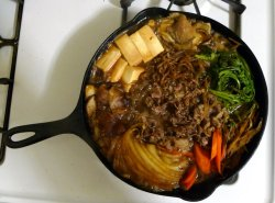 Sukiyaki Ingredients:  sukiyaki beef (beef sliced about 1/8 inch thick, find in Asian markets) tofu shaved burdock root (whittle like a pencil) sliced onions shiitake mushrooms oyster mushrooms sliced carrots itokonyaku (konyaku noodles) Warishita (Sauce) Ingredients: 1 part sake 1 part soy sauce 1 part mirin a sprinkling of sugar Directions:  Mix together sake, soy sauce, mirin, and sugar in a small bowl and set aside.  In a cast iron skillet grease the pan lightly and let it heat up.  Place all of the ingredients in neat clumps around the pan and pour the warishita sauce over everything.  Once beef is thoroughly cooked, take off the heat.  To eat, beat one egg in a small bowl. Take the ingredients and dip it into the egg and eat! (This is optional, but the traditional way to eat it. Plus it adds richness.)