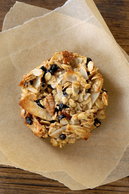 Blueberry Coconut Pecan Breakfast Cookies Ingredients: 1 1/2 cups gluten-free rolled oats 1 cup unsweetened coconut flakes  1 tablespoon golden flaxmeal 1/2 teaspoon salt 3/4 cups coarsely chopped pecans 1/2 cup dried blueberries 3 very ripe bananas, mashed 1/4 cup coconut oil, warm enough to be liquid 1 tablespoon agave nectar 1 teaspoon vanilla extract Cooking spray Directions: Preheat oven to 350°.  Combine oats, coconut, flaxmeal, salt, pecans, and blueberries. Stir in bananas, oil, agave nectar and vanilla until well combined. Press 2 tablespoons of mixture into a 2 1/2-inch round cookie cutter onto a baking sheet coated with cooking spray. Continue with remaining mixture. Bake at 350° for 25 minutes or until fragrant and golden. Cool on pan.