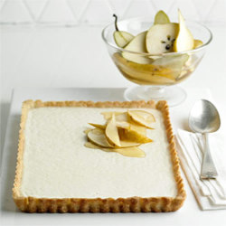 Vanilla Tart with Nutmeg Crust and Spiced Pears Spiced Pears Ingredients:  1½ cups white wine ½ cup Poire William (pear liqueur) or pear nectar 2 Tablespoons sugar 1 vanilla bean, split lengthwise or 2 teaspoons vanilla 3 sliced firm, ripe pears Crust Ingredients: 7 Tablespoon unsalted butter, melted ¼ cup sugar ¾ teaspoon Tahitian vanilla extract or vanilla extract ¼ teaspoon salt ⅛ teaspoon freshly grated nutmeg 1 cup unbleached all-purpose flour Filling Ingredients: ¼ cup sugar 2 Tablespoons plus 2 teaspoons cornstarch ⅛ teaspoon salt 2 cups half-and-half 2 teaspoons Tahitian vanilla extract or vanilla extract Spiced Pear Directions: In large saucepan combine white wine, Poire William (pear liqueur) or pear nectar, sugar, and vanilla bean vanilla. Bring to boiling. Reduce heat; simmer, uncovered, 25 minutes or until reduced to 1 cup. Stir in pears. Return to boiling. Reduce heat and cover. Simmer 5 to 8 minutes more or until pears are crisp-tender. Remove from heat; cool. Refrigerate until ready to serve. Crust Directions: For nutmeg crust, position rack in lower third of oven. Preheat oven to 350°F. In medium bowl combine butter, sugar, vanilla, salt, and nutmeg. Add flour; mix just until well blended. If dough is too soft, let stand a few minutes to firm up. Evenly press dough on bottom and sides of a 9- to 9-½-inch square or round tart pan in a thin layer. (This takes patience, as there is just enough dough.)  Refrigerate 30 minutes to firm the dough. Place pan on baking sheet. Bake 20 to 25 minutes, until crust is a deep golden brown, checking after 15 minutes. If dough has puffed from bottom of pan, prick a few times and gently press down with back of a fork. Cool in pan on wire rack. Filling Directions: In heavy medium saucepan whisk sugar, cornstarch, and salt to blend.  Add 3 Tablespoons half-and-half and whisk to form a smooth paste. Whisk in remaining half-and-half. Using a heat-proof spatula or wooden spoon, stir constantly over medium heat, scraping bottom, sides, and corners of pan until filling thickens and begins to bubble. Cook and stir 1 minute more to fully cook cornstarch. Stir in the vanilla extract. Immediately pour into crust, leveling with spatula. Cool 1 hour, uncovered, at room temperature. Refrigerate in covered container to cool completely.  Serve with spiced pears.