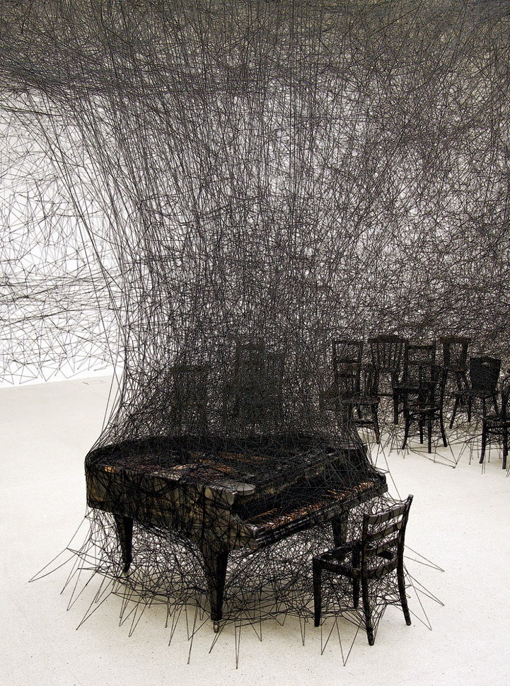 samaralex:  In Silence by Chiharu Shiota  Though the piece echoes sketch-like imagery, it is in fact an installation piece involving a burnt piano in a room ravaged by black wool…inspired by Shiota's own traumatic memories as a child, having witnessed her neighbor's house burn down. The charred piano is a direct memory of her neighbor's grand piano blazed up in smoke.