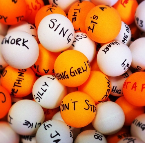 kurhummel:  Every song ever sung on Glee written on ping pong balls to celebrate Glee's 400th musical perfomance day. (photo taken by Mo Jangles on set yesterday)