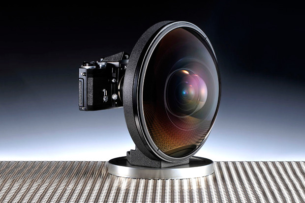 "The Fisheye-Nikkor 6mm f/2.8 lens, first produced in 1970 at the Photokina trade show in Cologne, holds the distinction of not only offering an angle of view of 220º, but also being known at the time as the world's most ""extreme wide-angle"" lens. The lens officially went into production in 1972 and uses 12 glass elements in nine groups with a total weight of 5.2kg. #"