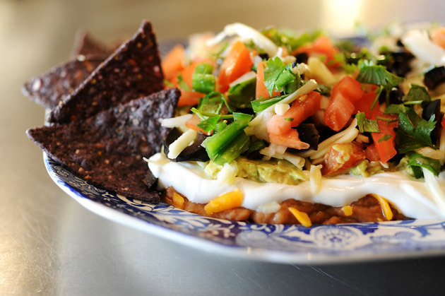 Pioneer Woman's mexican layer dip.  i'm going to need this, like yesterday.