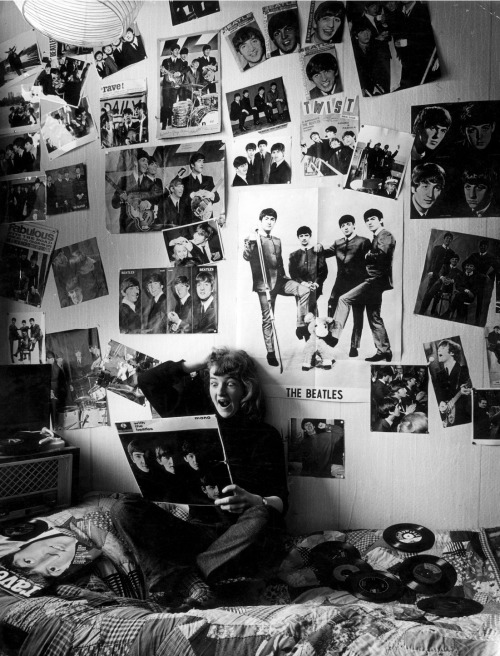 theswingingsixties:  A teenage Beatles fan in her room, 1964. Photo by Peike Reintjes.   Reminds me of when I was a teenage MCR fan.