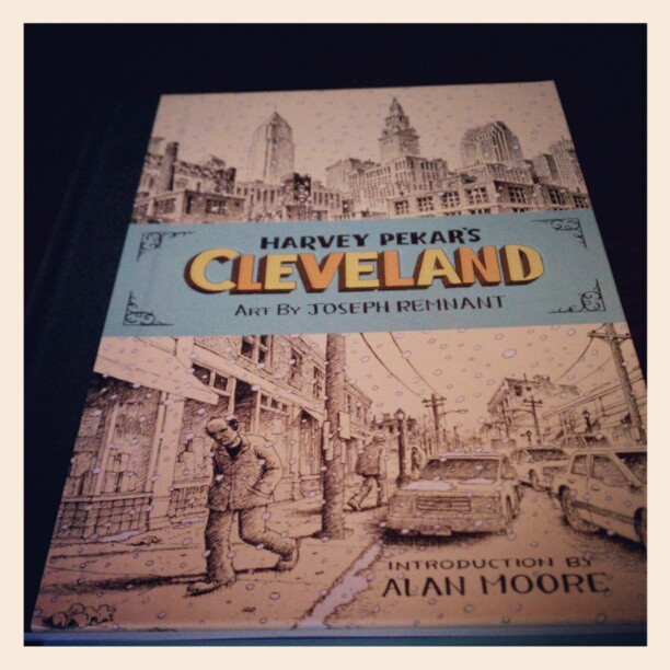 "I managed to get the last copy of Harvey Pekar's Cleveland at Bergen St. Comics about a week ago, just before seeing A Cabin in the Woods. I've been waiting for this book for two years. Like quite a bit of Pekar's work, this is focused on Cleveland (really they've all been in some way or another ""about Cleveland""), but this is really more a history book of his hometown. It is totally appropriate that his writing career would end on this note. Funny how that happens when a writer's life ends, their last piece of work is on something that you couldn't imagine being more appropriate. As if they knew.   He boils it down simply, as usual. There's nothing flashy happening in this book at all, the life of the city and how it relates to Harvey is the action. One panel, one narrative caption or piece of dialogue, pages are either five or six panels so it's a thick read. Pekar is the king of, as my Mother says, ""Keep[ing] it simple, Stupid."" He doesn't try anything overtly flashy, he's just straight forward and tells you how it is. Pekar is the definition of that latter statement. Joseph Remnant's detailed art is amazing, he portrays Pekar and Cleveland's life as it appears from amazing historical depictions on the founding of the city, and the faces of the people in the city. No one in this comic looks like someone you might recognize, and now I understand why it took so long for it to come out. Remnant took the time to make Pekar's last work, the root of it in the city and its people, and make the populace look completely unique. You may not read a graphic novel this year that has such distinct faces. I think this is accentuated because the art is black and white. Everyone has a particular look and the attention is amazing. Right down to the cuts between younger Pekar, his face and the modern Harvey are so perfectly portrayed. You can see the wild-eyed excitement in both of their eyes even though they're in two different periods. The hairlines, the wrinkles, the slouch, etc. From Harvey in the sixties to Harvey in 2009. One chapter of his life to the current one, narrating the story, we can pull out Harvey in the crowd. It would be stating the obvious that this is a love letter to a city, a cartographic piece, but that, on the surface, is the first motive in non-fiction, usually though, in very good non-fiction, it ends up going deeper. The heart-wrenching moment is really the end, of course, because it seemed like there was still more Pekar wanted to say, his last line is so bittersweet, but it just stops abruptly and he walks off the page, and the city goes on for another page without him. He exits the stage. But that's how it goes doesn't it? There is more to say but you don't get to say it anymore, do you? You just stop. Your home goes on without you, even though you helped define it for a moment. And it seems like that was intentional, per an article my friend Rick Marshall did. Pekar, as in life, portrays the end in a way I imagine it must be like.  There are many questions the book asks, the answers I have absolutely no hope in solving. How much does a city define a writer, or vice versa? Does the writer leave any mark? Does he or she change a city? I choose to think they help to define a city's period, but that is just a surface-level detail. That's my shortcoming, I can't dive very deep. I'm always just on the surface. These are universal questions that occur when it comes to writing non-fiction, especially the pioneering mission Pekar has been on since the early seventies. Inevitably who you are as a creator comes out of where you're from, and that seems to be something that Pekar has been trying to answer his entire career. Thanks for this, Mr. Pekar and Mr. Remnant, see you on the other side."