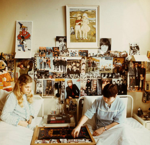 thegilly:  Two girls in a Dutch sanatorium have decorated their hospital room with band posters and photographs, dolls, and a James Bond game between their beds. Photo by Schröter