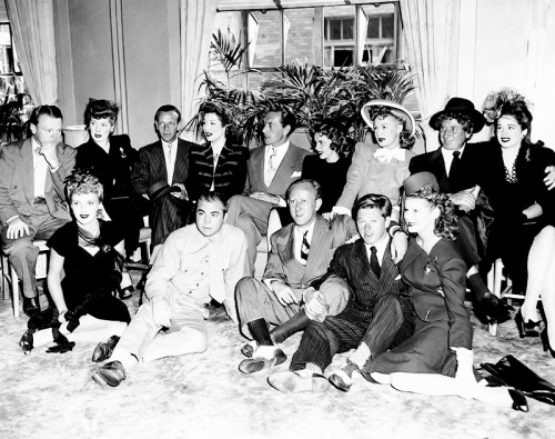 Lucille Ball photographed with James Cagney, Fred Astaire, Greer Garson, Paul Henreid, Judy Garland, Betty Hutton, Harpo Marx, Ruth Brady, Kay Kyser, and Mickey Rooney
