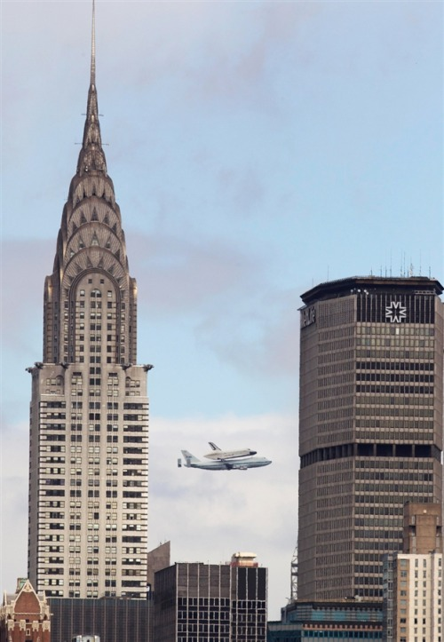 Top: Space Shuttle Enterprise going over NYC in 1983. It was on its way back from the Paris Air Show. Bottom: The Space Shuttle Enterprise rides atop a NASA modified 747 plane over New York on April 27, 2012. The Space Shuttle Enterprise officially arrived in New York to be placed at the Intrepid Sea, Air and Space Museum.