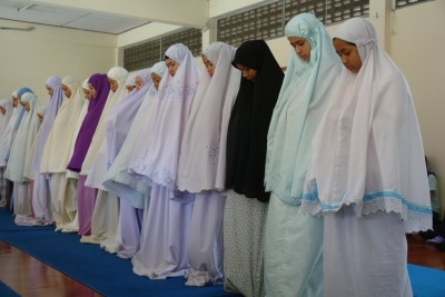 Students observing the routine of Zuhur at the mosque in Chiang Mai
