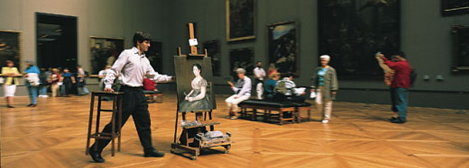 American artist Will Thompson at the Louvre with his take on Goya's Young Woman with a Fan.