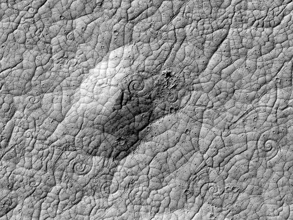 "ikenbot:  Huge Spirals Found on Mars—Evidence of New Lava Type? Coils hint that volcanoes, not ice, shaped odd red planet region. Hundreds of large spirals have been discovered on Mars, and scientists think the coiled features are evidence of a type of lava flow never before seen on the red planet. If so, the spirals would suggest that volcanoes—not ice floes, as other experts believe—shaped an unusual area near the red planet's equator. Athabasca Valles is a region of flow channels and valleys covered with terrain plates, structures that show clear evidence of something fracturing and drifting across the planet's surface millions of years ago. Scientists have been divided, however, as to whether the plates were made by the hardening of a massive lava flow or by icy ""rafts""—much like Arctic pack ice—from an ancient inland sea. Continue.."