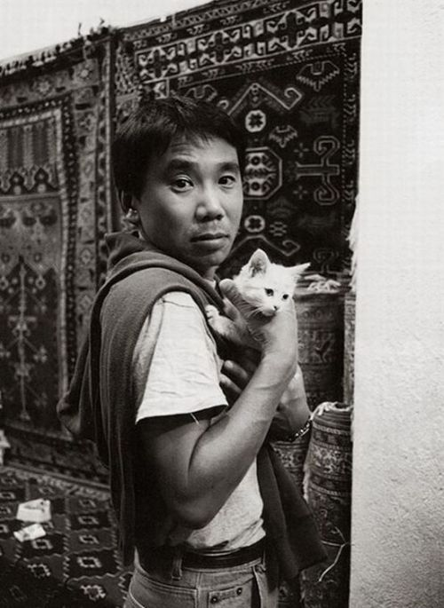 murakamistuff:  Haruki Murakami Interesting fact: The cat in this photo is named Kafka.