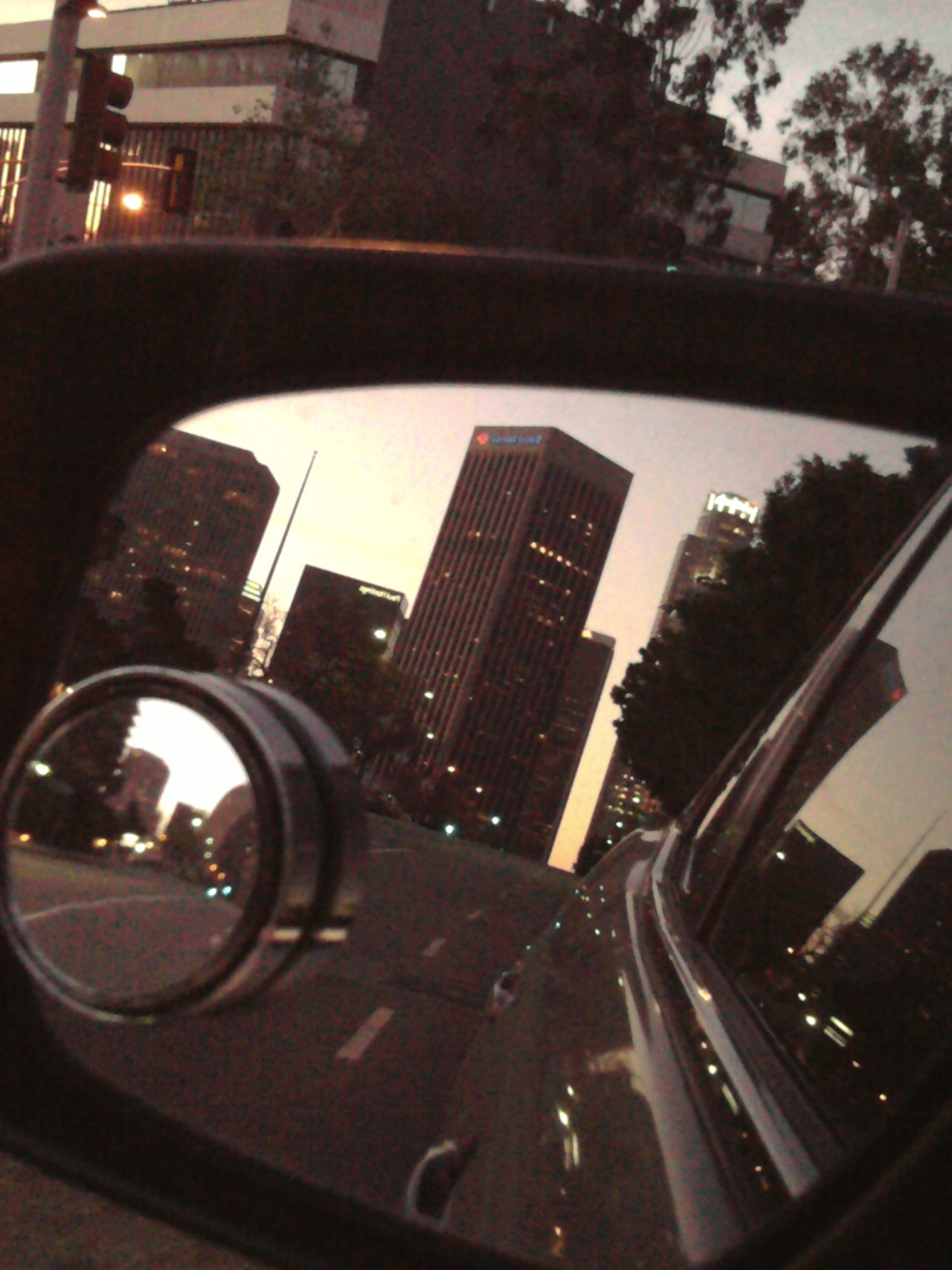 Reflections of Downtown Los Angeles through a side-mirror. Remembering April 29, 1992. #LARiots