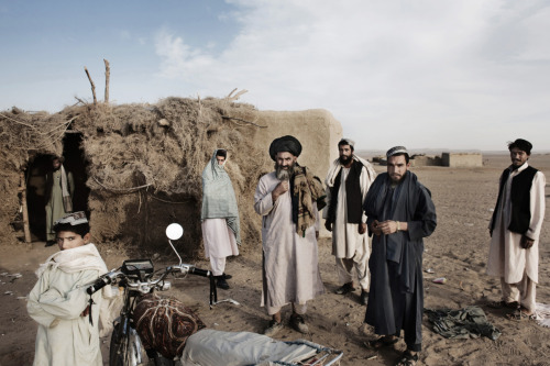 Villagers in the Garmsir District of Helmand Province emerge from their homes shortly after gunmen attack a foot patrol of U.S. Marines. Photo: Mikhail Galustov The war in Afghanistan is not over. Help us tell the story. Fund our Kickstarter.