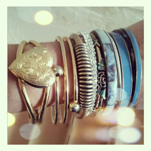 My favorite armparty - (from left to right) vintage locket cuff via Clotheshorse Consignment in Englewood, FL, thrifted bangle from this post, Jewelmint bracelet c/o Jewelmint + The Glitter Guide giveaway, rhinestone bangle c/o InPink + My Style Pill giveaway, rose bangle gifted by my grandmother from her trip to Hong Kong, yard sale finds, & thrift