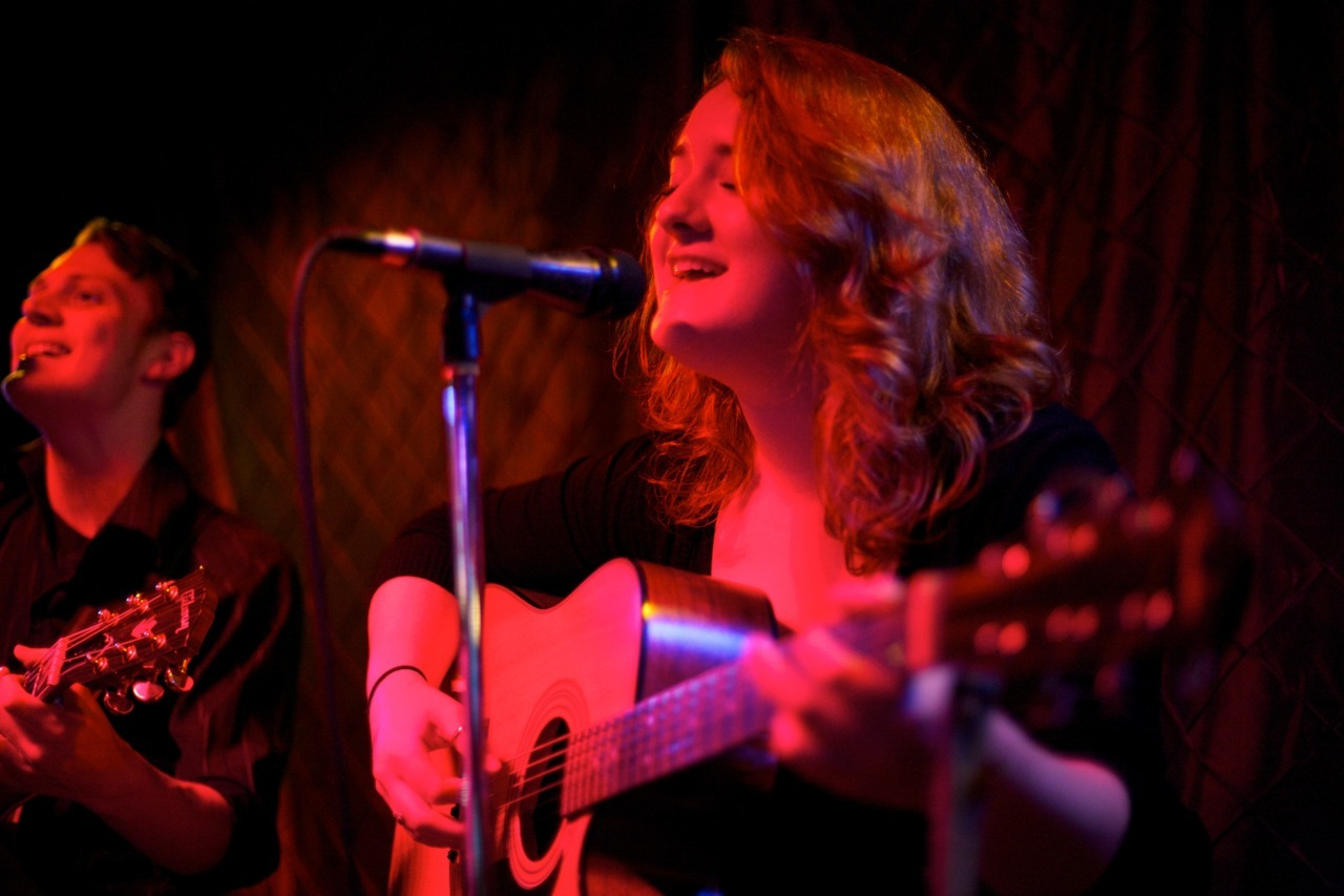 Molly Robison performing with her musical partner, James Bence, in their folk acoustic band, Bittersweet Drive, at The Elbo Room in Chicago IL.