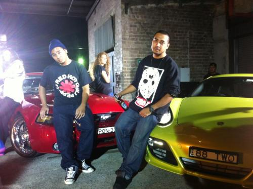 me and my brother on the set for my sister's partner's music video. two porsches, one mustang, one lowrider and one stripper. awesome