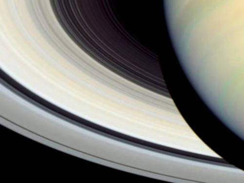 expose-the-light:  Zooming in on Saturn's Rings Credit: NASA, ESA and E. Karkoschka (University of Arizona) Saturn is ready for her close-up. This image, taken by the Hubble Space telescope in 2004, offers a stunning view of the planet's rings. Saturn boasts 9 continuous main rings as well as three fragmentary arcs; they're made mostly of ice with some dust and rock mixed in. In this image, the main body of the planet casts a dark shadow on the rings.