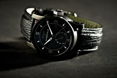 Schofield Watch Company - The Signalman DLC on black sharkskin In construction and design the Signalman is inspired by the great British lighthouses of the 18th and 19th Centuries. They, like the watch, stand as a testament to great British engineering, impeccable timing and precision. They also encompass an English quirkiness and individuality which sits well with the English-based company and Giles Ellis himself.