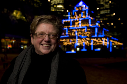 "Robyn Archer - Artistic Director of Light in Winter 2011; www.fedsquare.com In front of ""Light Hearts"" - Bruce Ramus; www.ramus.ca capture D3, process Bridge, PS www.fred.net.au"