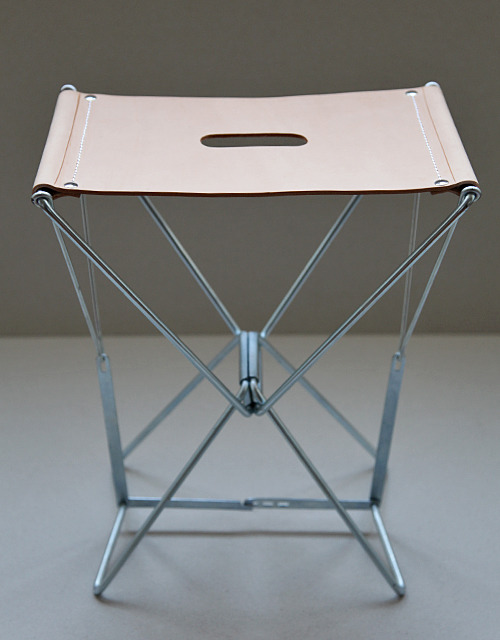 adaism:  THE BANQUINHO N°2 STOOL BY ADAISM The base of this folding stool is old stock from the Portuguese company ICA Designed in 1955 by António and Luís Pereira for pilgrims on their way to Fátima Now it comes with a seat in vegetable tanned calf leather  with a characteristic grip hole Size 31 x 21 x 38 cm | 12.2 x 8.2 x 15 inches