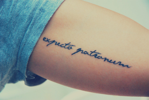 """fuckyeahtattoos:  My first tattoo, done by Joe Finch at Ink By Finch.It says 'Expecto Patronum', a spell in Harry Potter which has deep meanings for me.From the first time I read the book and the spell came out I already fell in love with the concept and ideology that J.K. Rowling came up with. The spell actually means 'I await for a protector"""" in Latin.In the Harry Potter itself, 'Expecto Patronum"""" is used to repel Dementors. Dementor is the guard of the Azkaban prison, a dark creature that absorbs your joy and happiness. So, in other words, the spell is used to repel all the bad aura that wants to steal happiness from me. The unique thing about it is, if you want to cast the spell, you have to think of things that make you happy. The happier your memory is, the stronger your patronus will be.That's what I hope I will see every time I look at my tattoo, the pictures of places I've been to, my good friends, families, and all the good memories I've had with them. I got them all in my arm as my Patronus.So, what's your strongest Patronus?"""