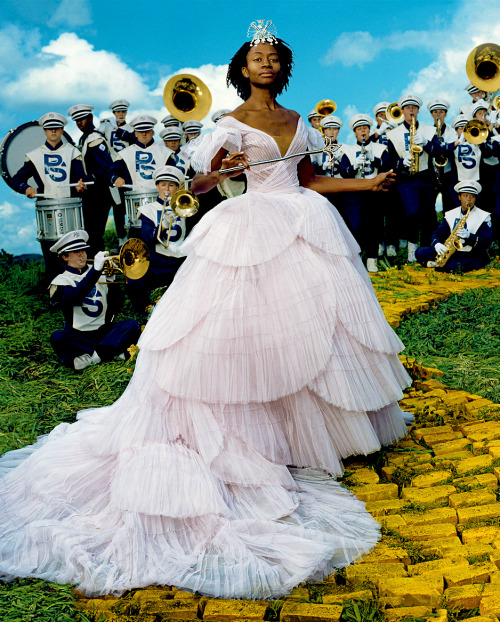 newmodelminority:  nichelle:  Princess with the marching band.  She looks like Kara Walker…but I don't know Ms. Walker to pose for photos…this could have been in a magazine..  It is, in fact, Kara Walker. Even more context she is Glenda the Good Witch note the yellow brick road. I want to say Vogue. I vaguely remember the spread which features cute little Dorothy dresses and red pumps. And Ms. Walker is not a stranger to the camera by any means (or the pages of Vogue).