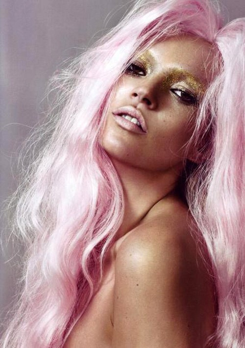 A pink haired and golden eyed Kate Moss photographed by Nick Knight