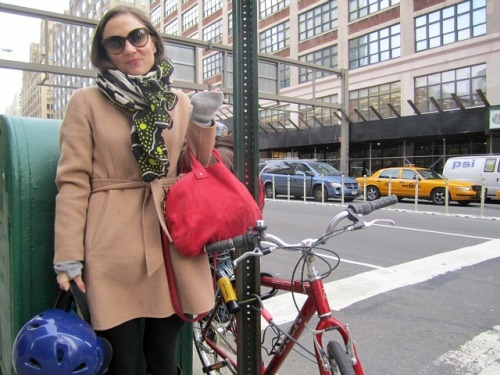 "Just found this: Cyclists Change the Face of Growing Hudson Square  (Hi guys!)  Green buildings consultant Nora Sherman, who commutes on her beat-up Trek from the East Village to her office in Hudson Square, noted the high-end Italian racing bikes she sees outside the offices of WNYC Radio and other creative companies on Varick Street.  ""I'm always a little embarrassed about my sad little bike next to all the road bikes and Brooks leather saddles,"" Sherman, 30, said Wednesday morning as she chained her Trek to a street sign.  It's true, my bike is not pretty but it gets the job DONE. PS: I insisted on holding my helmet in the picture."