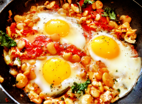 Eat Clean Diet Vegetarian Cookbook - Skillet Eggs in Rustic Tomato Sauce with Butter Beans How fabulous does this look?  Well it was, we devoured every last beautiful bite this morning for Sunday brunch.   Tosca Reno's wonderful and easy skillet eggs recipe was a hearty meal and the combination of ingredients felt as though we were dining on a farm!  For the recipe, I used farm fresh eggs from the Farmer's Market as well as fresh herbs. This recipe can be made with egg whites for those who prefer and can also be made vegan by omitting the eggs.  What I love most about The Eat Clean Diet Vegetarian Cookbook, is that it offers something for everyone. I would definitely make this recipe again and even enjoy it later in the day for one of my main meals!