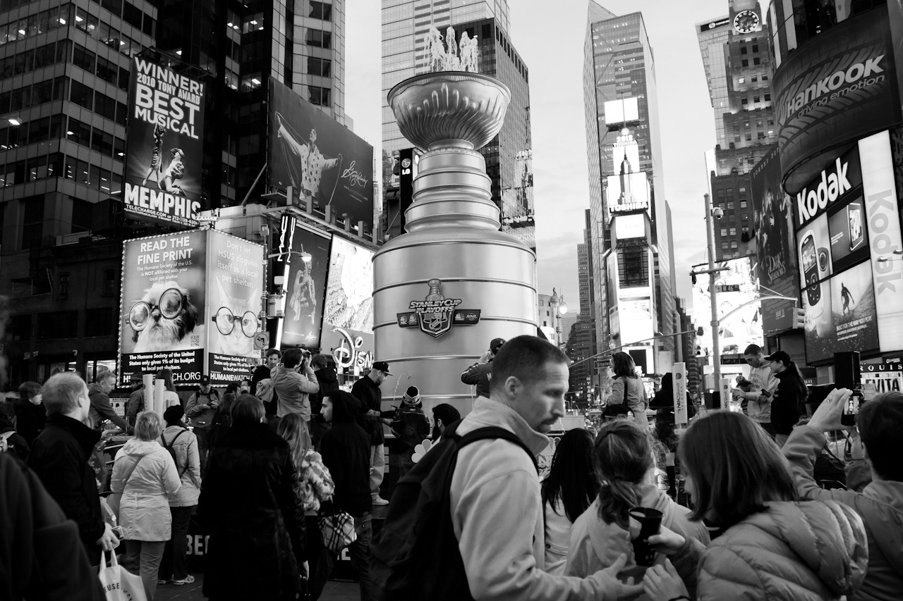 Drink from the Cup People gather around a 21-foot-tall, 6,600-pound replica of the Stanley Cup in Times Square. The giant drinking fountain celebrates the beginning of the 2012 NHL playoffs on NBC Sports.