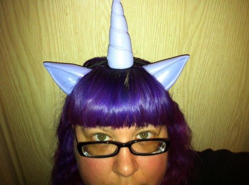 I'm a uuuuuuuuunicorn! on Flickr.Pony ears and the unicorn horn Ashley made for me for my Twilight Sparkle cosplay that I'll be doing at Dragon*Con.  I need to get the wig still and figure  out how to add the pink and purple strips to it.  Then I suppose I need to find a suitable shirt to go with my skirt that I'll be wearing.  Also gotta see about doing the cutie mark on my purple converse.