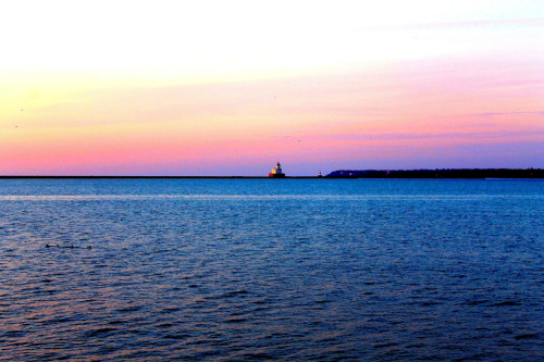 artofmilwaukee:  The lighthouse off of Lake Michigan at a distance.
