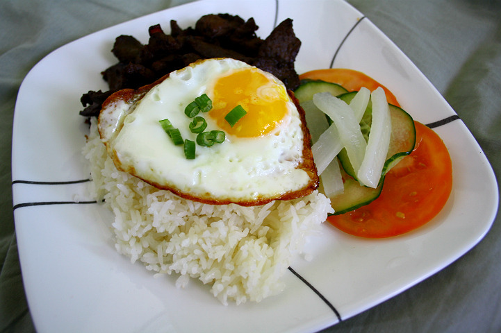 bonappetitme:  Tapsilog.  Best filipino breakfast food alive. lol FYI, it is not viet food. It's made with cured beef which makes it different from the common grilled pork/chicken, rice and pickled veggies.  Mmmm…. BEST FILIPINO BREAKFAST EVER.