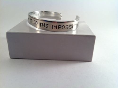 "A GIVEAWAY! Winners Win this this Walt Disney quote bracelet ""It's kind of fun to do the impossible"" and a Ellie Badge Necklace!     Check out the shop here http://www.etsy.com/shop/DinglehopperDesigns This Shop is simply wonderful and I have a long list of things I want to get from it! a few dozen Necklaces, a few bracelets.  The Bracelet up above is 100% Pure Aluminum. Hand Stamped with the quote.  the Ellie Badge Necklace is A bottle-cap style pendant, styled after the Ellie Badge from UP (READ POST CAREFULLY TO MAKE SURE YOU KNOW HOW TO BE ELIGIBLE TO WIN)    Starting Date of Contest: April 27rd, 2012 Closing Date of Contest: May 16th, 2012 Goal of Contest: reblog this post!  For more chances you can:  1.You can tweet the page, Pin it or facebook and message me the link and I will add your name in for more chances to win! Good Luck! 2. Love it here on Tumblr or reblog it!  3. Send me a Disneyland Magical Memory story saying what Disney thing has inspired you most and say at the bottom you want your name entered again in the entry.  How to Win:  Step 2- you must be a follower to Disneyland Guru  Step 1- Reblog this post (just once)  Rules and Regulations: - Must live Somewhere on the planet. -Must have a positive blog- this means that blogs that promote destructive behavior are not eligible to win. -No blog bashing (including mine). This is a friendly contest! - Contestants can spred the word for a contest. Send me links to where you spread it for more chances to win! - Must be of the age where parents or legal guardians don't mind you receiving personal mail. *for additional questions please message me"