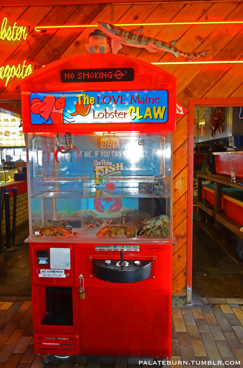 An arcade claw game with live lobsters at the San Pedro Fish Market in Ports O' Call Village in San Pedro, CA.