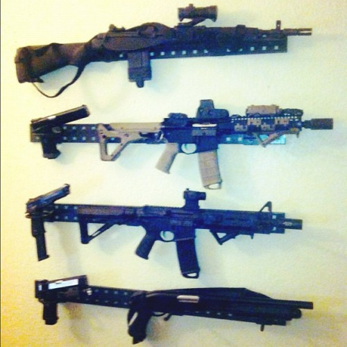 I'm inspired to copy @daring5000 BIG BOSS' awesome gun wall setup. #airsoft #gun #wall #mount #mancave #peg #setup #m4 #m14 #magpul #tactical #m9 #infinity #awesome #rifle #pistol #killingangels (Taken with Instagram at Outer Heaven)