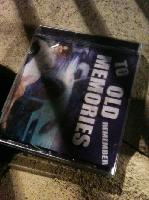 This cd has been sitting inbetween the bars of my apartment complex's gate for a solid two weeks. I always feel bad when I walk past it. But I never pick it up.